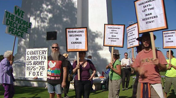 Protesters rallied at the Peace Arch border crossing south of Vancouver on Tuesday morning against a Federal Court decision to deport Robin Long.