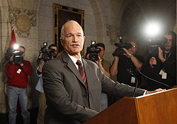 NDP Leader Jack Layton responds to questions on Wednesday in Ottawa over Liberal Leader Michael Ignatieff's decision to support the budget, with conditions.