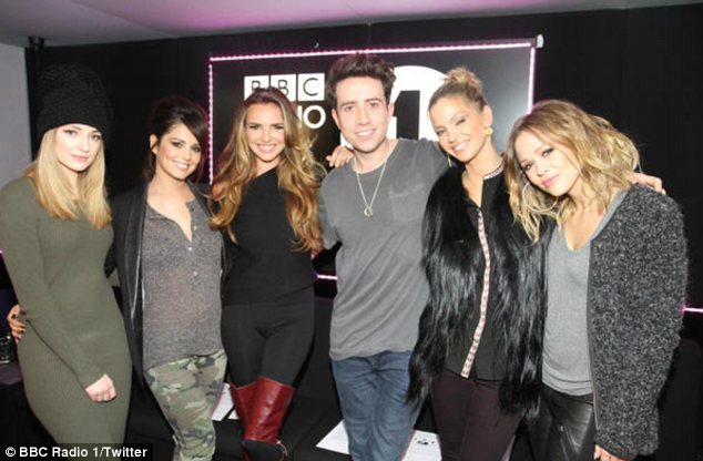 Girls very aloud: Nadine didn't mind that she had swore on air and was seen posing up with Nick Grimshaw and the rest of her bandmates