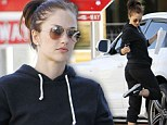 What's on my shoe? Minka Kelly checks soles of trainers for gunk after gruelling work out session