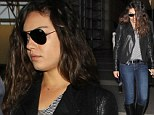 Take off: A tousled haired Mila Kunis looks airport chic in jodhpur boots and leather jacket as she leaves Los Angeles