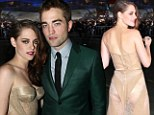 That outfit is scandalous! Cheeky Kristen Stewart vamps it up in a sheer gold dress as she is reunited with R-Patz for Twilight Breaking Dawn Part 2 premiere