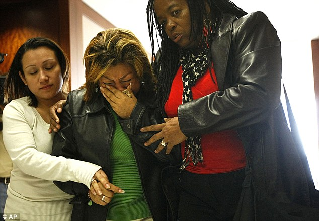 Emotions: Rosie Castillo, center, grandmother of 16-month-old day care fire victim, Elias Castillo, reacts after walking out of the closing arguments yesterday