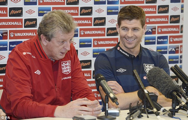 'Role Model': Gerrard, with England manager Roy Hodgson (left), was described as such by the deputy head