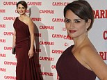 A vision in red: Penelope Cruz commands attention at launch of her 2013 Campari calendar in asymmetrical gown