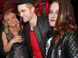 All covered up: Kristen Stewart, right, swapped her sheer dress for jeans and a jacket while Nikki Reed covered up with a dress at the afterparty for The Twilight Saga: Breaking Dawn - Part 2