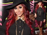 Snooki sees red! Jersey Shore star teams her newly dyed mane of hair with matching leather trousers at perfume launch