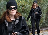 All she needs is a swag bag! Julianne Moore looks like cat burglar as she prowls around in head-to-toe black, a beanie and fingerless leather gloves