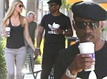 Smitten! Eddie Murphy and his blonde girlfriend mirror each other's body language while getting coffee