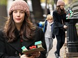 Taking after his mother! Make-up free Liv Tyler proudly carries her son Milo's creative project as they walk home from school