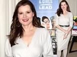 You could have done without those! Geena Davis spoils her pretty dove-grey dress by wearing unflattering matching tights