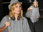 That was exhausting work! Make-up free Heidi Klum keeps it low-key after an astounding SIX crazy costume changes for MTV Awards