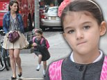 Katie Holmes flaunts her pins while Suri jumps puddles on their after-school stroll
