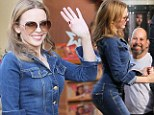 Now that's how you wear double denim! Kylie Minogue shows off her pert posterior in matching jeans and jacket