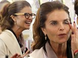 Let me make you over! Maria Shriver is plastered in make-up at the hands of daughter Katherine on shopping trip