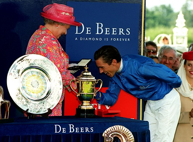 Frankie Dettori receives his prize from The Queen after winning the King George VI & Queen Elizabeth Diamond Stakes on Daylami at Ascot in July, 1999