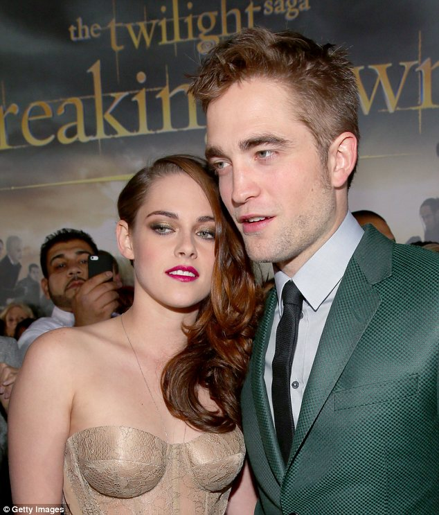 Coming to town: Kristen Stewart and Robert Pattinson looked happy together at the LA premiere of the film on Monday. They will be at the London premiere on Wednesday