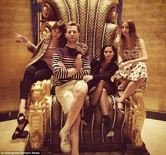 Chic: Alexa relaxes with pals... on a gold throne