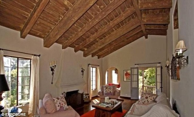 High roofs: Olivia has ditched the idea of living in a spacey Spanish-style home to move into a loft apartment to be near her boyfriend