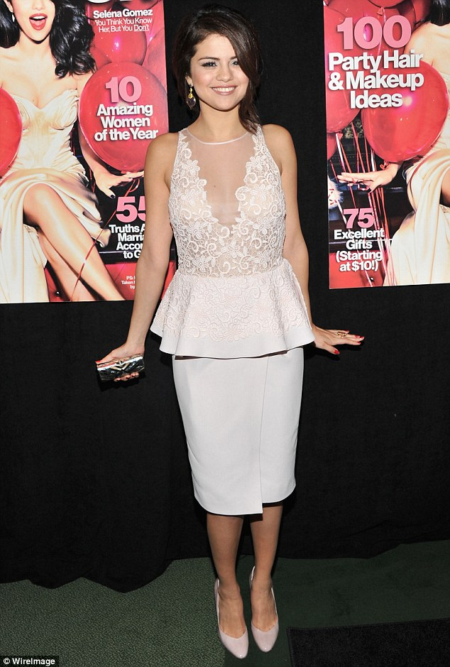 Put on a happy face: Selena braved a smile during the event despite her personal woes