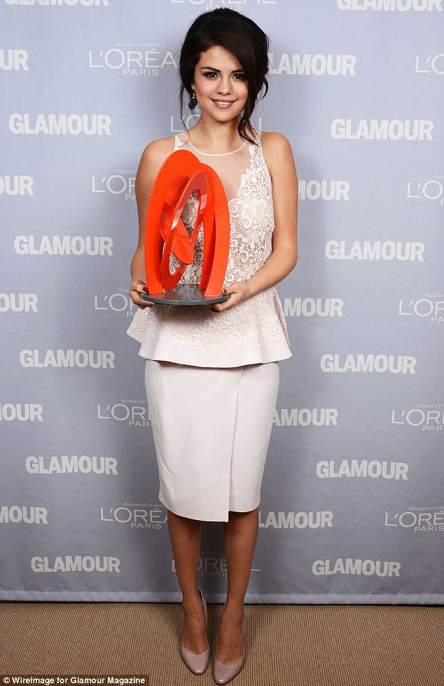 Proud: She later posed with her award for professional pictures