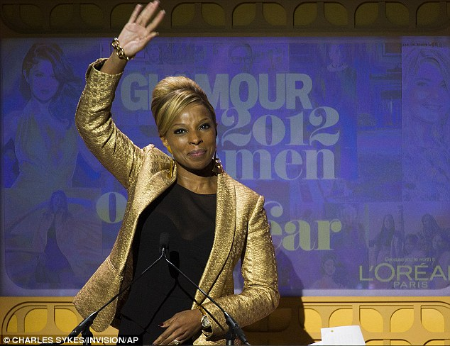 Gorgeous in gold: Blige slipped on a standout gold jacket as she made an appearance onstage