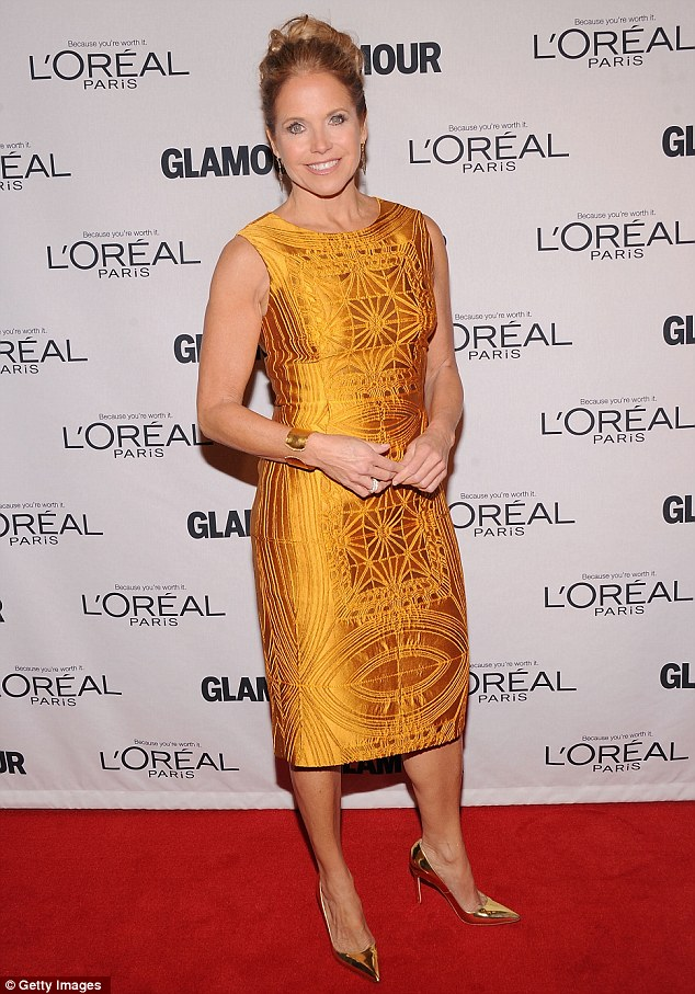 Gorgeous in gold: Katie Couric opted for a metallic shift dress and flashy gold heels
