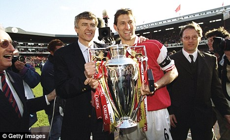 In days gone by: Tony Adams and Wenger celebrate the 1998 Premier League title
