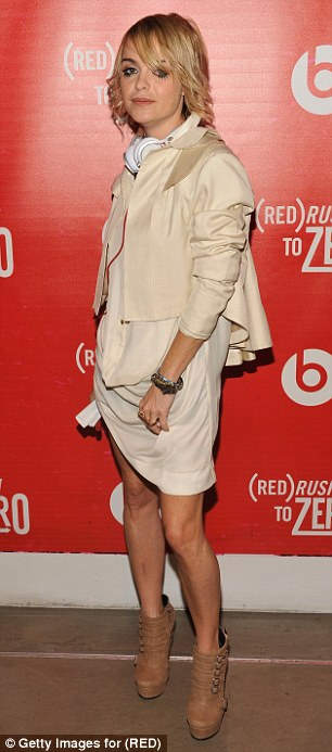 Girl about town: Taryn rocked leather shorts and a more demure cream ensemble at two parties in June