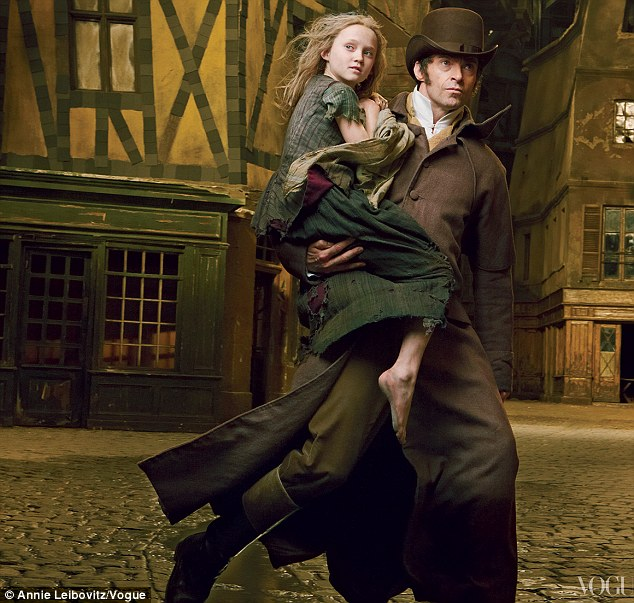 Redemption song: Hugh Jackman plays paroled prisoner Jean Valjean who seeks redemption be looking after a young Cosette, played by Isabella Allen