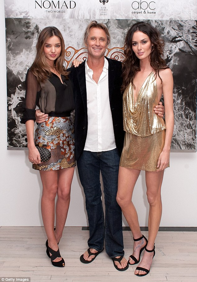 Socialising: The beauty cosied up to other guests at the party, including Russell James and Nicole Trunfio