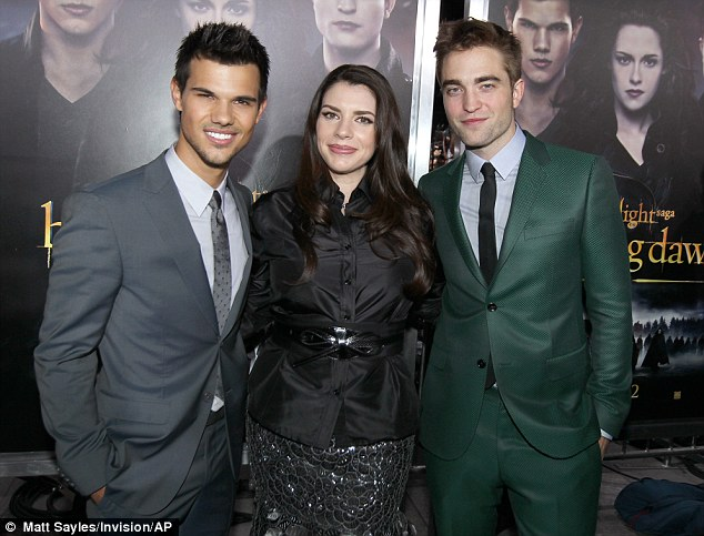 Lucky lady: Stephenie poses in between the two male leads Taylor and Robert