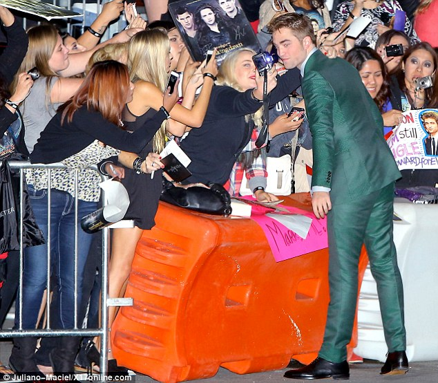 Thumbs up: They hadn't seen the film yet, but the fans loved R-Patz's outfit