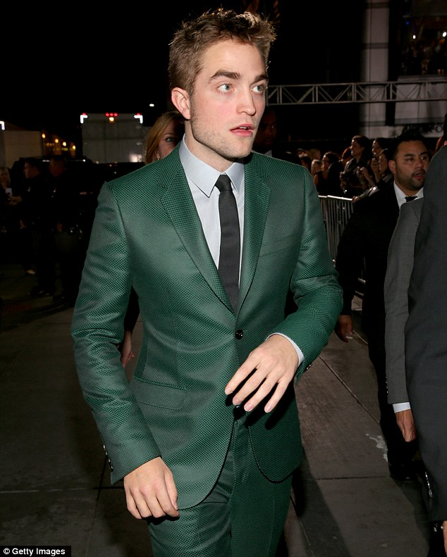 Grand entrance in green: Robert looks gobsmacked as he arrives at the event to the tune of screaming fans