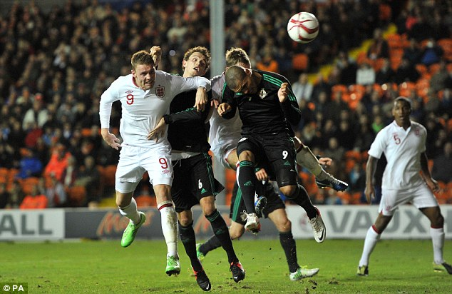 Head boy: Wickham scores the opening goal of the game at Bloomfield Road