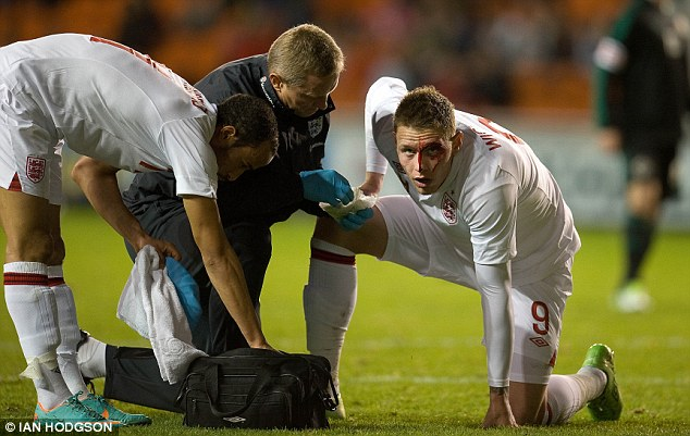 Bloody mess: The goalscorer returned to the pitch with four stitches for a head wound