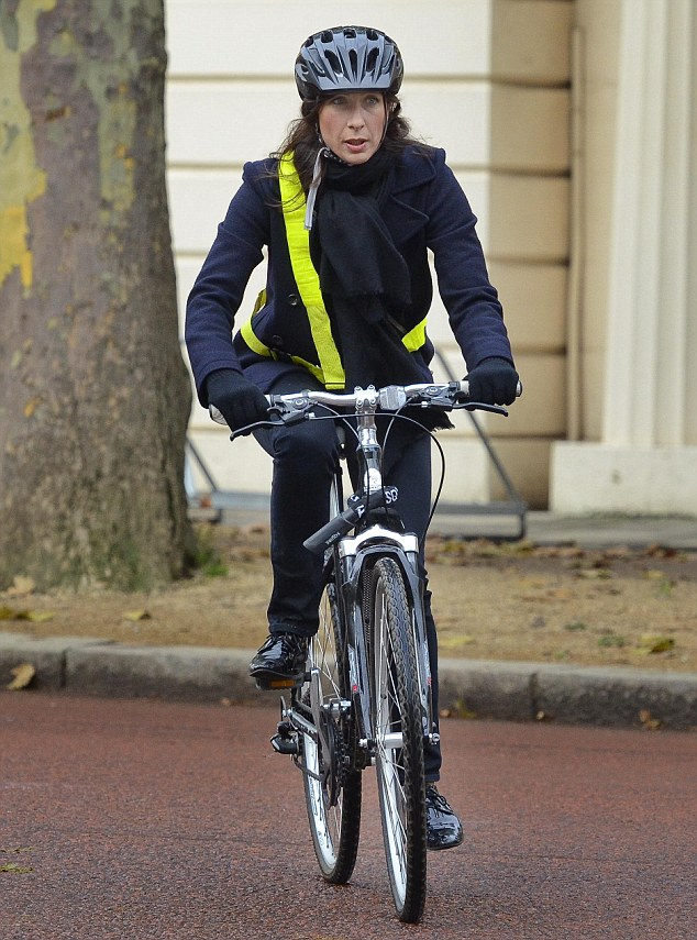Samantha dressed sensibly for the cool autumn morning, wearing a navy wool coat, dark jeans and patent brogues