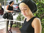 Miley Cyrus heads to the studio with mom Tish showing off her midriff.