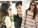 Who needs a private jet! Katie Holmes makes her daily subway commute with a handsome companion in tow