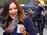 Trolley dolly: Katherine McPhee hitches a ride with the cameraman on the set of her hit musical drama Smash