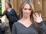 Jennifer Love Hewitt wears ratty grey shirt and jokes around with castmember on the set of The Client List