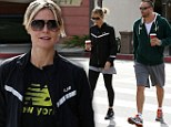 Back with her beloved: Heidi Klum can't help but smile as she is reunited with boyfriend Martin Kirsten after Europe trip