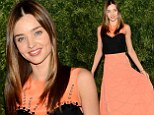 Pretty in peach: Miranda Kerr shows off her style credentials in demure dress at she attends CFDA and Vogue dinner