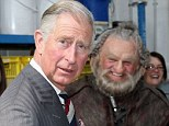 The Prince of Wales holds a sword after meeting Mark Hadlow who plays Dori in the new 'Hobbit' film