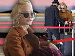 Still in the honeymoon phase! Carey Mulligan and Marcus Mumford are as smitten as ever as they jet out of LA