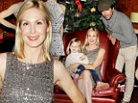 A family affair! Gossip Girl star Kelly Rutherford poses with on-screen husband Matthew Settle at Christmas spectacular
