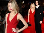 Debuting the little baby bump! Peaches Geldof shows off her pregnant shape as she and husband enjoy rare date night at Breaking Dawn premiere