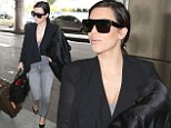 You will go to the ball: Kim Kardashian jets out of Miami airport to attend a Marine Corps gala
