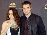 On-edge: Kristen Stewart and Robert Pattinson looked somewhat awkward as they posed alongside each other at the Twilight Saga: Breaking Dawn Part 2 photocall in Madrid, Spain