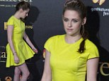Mellow Yellow: Kristen Stewart shows off her best pout as she steps out in a bold dress at Madrid Twilight premiere